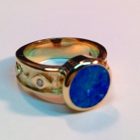 An opal doublet diamond ring intense color