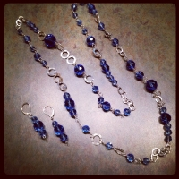 Dated graduated blue crystal beads repurposed to a 36in multi chain necklace