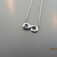 Infinity Pendant with Peridots to Honor Twins Born in August East Towne Jewelers