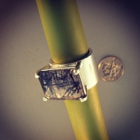 Silver ring with emerald cut black rutilated quartz