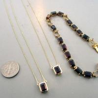 Yellow Gold Garnet Pendants from Grandmas Bracelet East Towne Jewelers