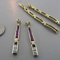 Yellow Gold Ruby and Dimond Earrings from Bracelet East Towne Jewelers