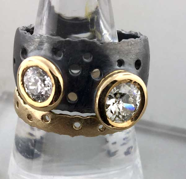 Custom Diamon Ring Blackened with Yellow Gold Bezels and Complementary Yellow Gold Band East Towne Jewelers