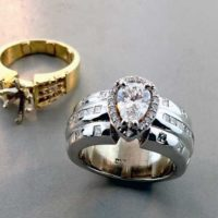 Custom Pear Diamond Ring in Halo with Original Ring in Background East Towne Jewelers Mequon WI