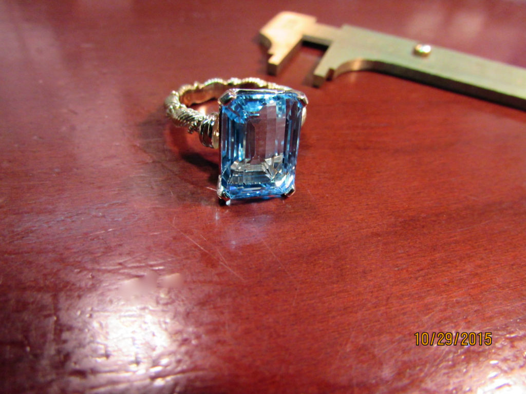 Large-aqua-reset-using-an-18kt-yellow-gold-vintage-handmade-shank