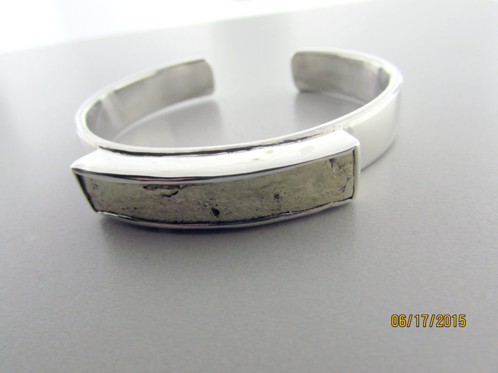 Raw-melted-yellow-gold-bar-on-a-sterling-silver-cuff