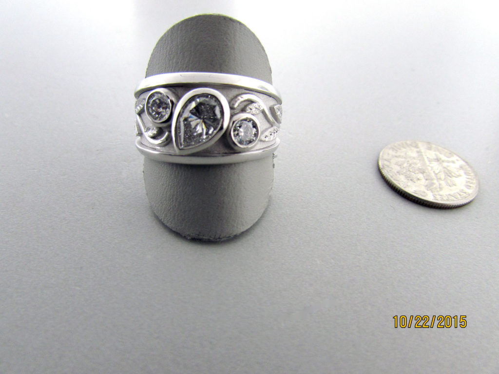Remake-a-new-ring-with-three-diamonds