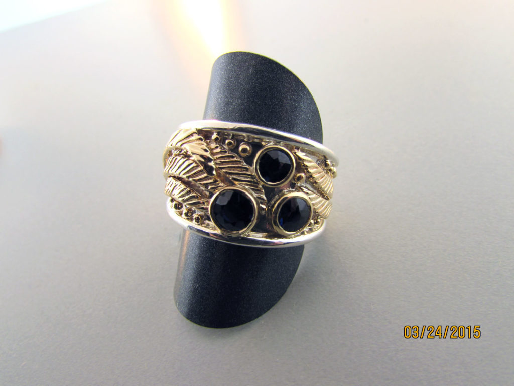 Repurposed-gold-leaf-parts-from-an-old-ring-redesigned-and-bezel-set-diamonds-into-a-new-ring-design